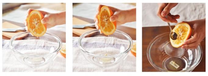 半分に切った橙を、ぎゅっと手搾り!